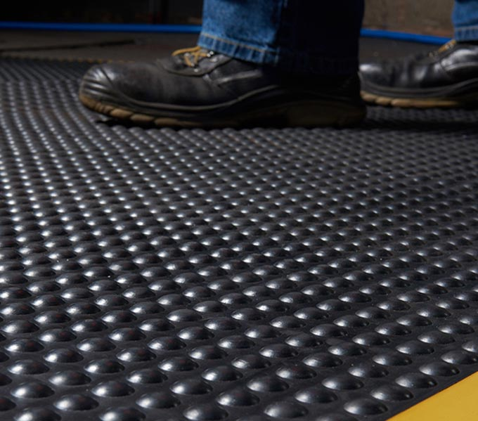 Commercial photography of floor matting and workman